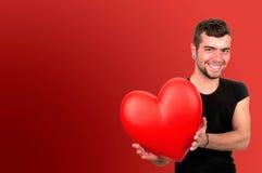 Young man holding heart Stock Photos