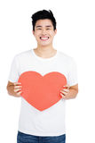Young man holding a heart shape Royalty Free Stock Photo