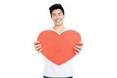 Young man holding heart shape Royalty Free Stock Photos