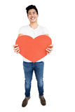 Young man holding heart shape Royalty Free Stock Photography
