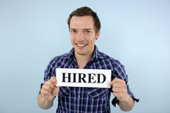 Young man holding hired sign Stock Image