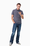 Young man holding his cellphone Royalty Free Stock Photos
