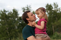 Young man holding his daughter Stock Photo