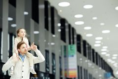 Man with daughter in airport Stock Photography