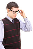Young man holding his forehead Royalty Free Stock Photography