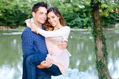 Young man holding his girlfriend Stock Photo