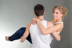Young man holding his girlfriend in hands Stock Image