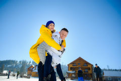 Young man holding his girlfriend on his shoulders Stock Photos