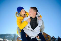 Young man holding his girlfriend on his shoulders Stock Photo