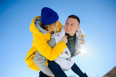 Young man holding his girlfriend on his shoulders Royalty Free Stock Images