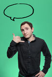 Young man holding his hand as telephone gesture Royalty Free Stock Photos