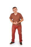 Young man holding his hands on his stomach with pain Royalty Free Stock Image
