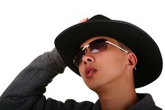 Young Man Holding His Hat Stock Images
