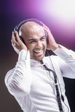 Young man holding his headphone Stock Image
