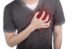 Young man holding his heart to this pain. Royalty Free Stock Photography
