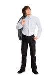 Young man holding his jacket looking up Stock Photos