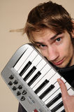 Young man holding his midi keyboard Royalty Free Stock Images