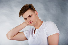 Young man holding his neck in pain. Stock Photo