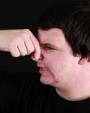 Young man holding his nose Stock Photos