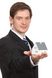 Young man holding home Stock Photos