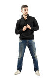 Young man holding hoodie strings looking down Stock Photo
