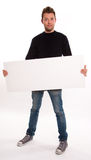 Young man holding horizontal signboard Royalty Free Stock Images