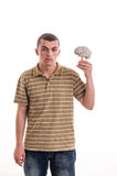 Young man holding a human brain model Royalty Free Stock Images