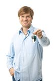Young man holding ignition keys Royalty Free Stock Photo