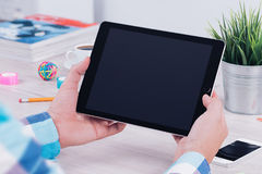 Free Young Man Holding Ipad Digital Tablet On Table Desk Stock Images - 99206204
