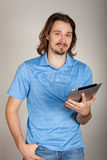 Young man holding ipad notebook Royalty Free Stock Photos