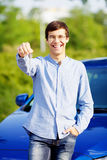 Young man holding key of his new car Royalty Free Stock Images