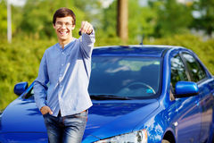 Young man holding key of his new car Stock Images