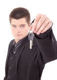 Young man holding keys Royalty Free Stock Image