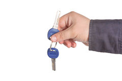 Young man holding keys in hand Royalty Free Stock Photo