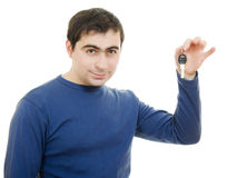 Young man holding keys in his hand Stock Photography