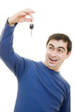 Young man holding keys in his hand Stock Photo