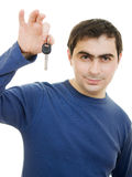Young man holding keys in his hand Stock Images