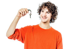 Young man holding keys portrait Royalty Free Stock Images