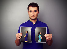 Young man holding the lacerated photo Royalty Free Stock Photo
