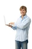 Young man holding laptop Stock Image