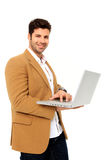 Young man holding a laptop. Young handsome man holding a laptop isolated on a white background Royalty Free Stock Images