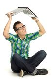 Young man holding laptop above head Royalty Free Stock Photos