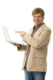 Young man holding laptop with blank screen Stock Image