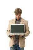 Young man holding laptop with blank screen Royalty Free Stock Photography