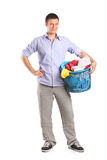 Young man holding a laundry basket Royalty Free Stock Image