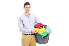 Young man holding a laundry basket Stock Photography