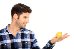 Young man holding a lemon Royalty Free Stock Images