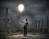 Young man holding a light Stock Image