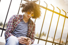 Young man holding and looking mobile phone Royalty Free Stock Image