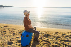 Young man holding luggage at the sea. Travel, summertime, holidays and people concept. Royalty Free Stock Photos